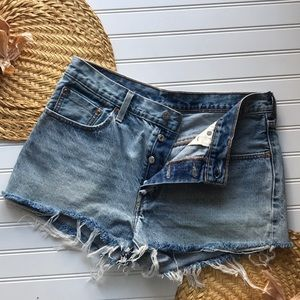 Levi's destroyed button fly denim shorts
